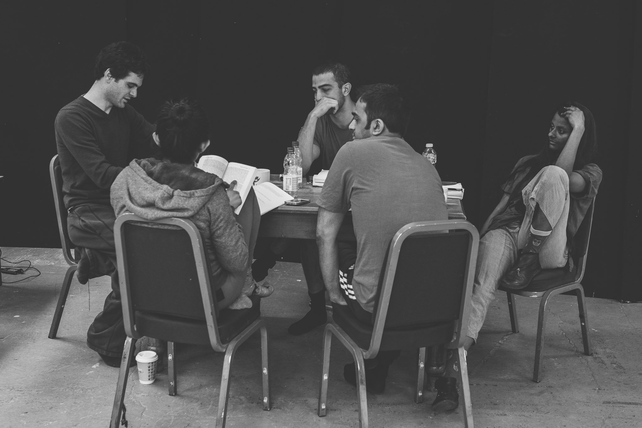 Actor's round a table discussing ideas Hand written research notes rehearsal Brighton Festival