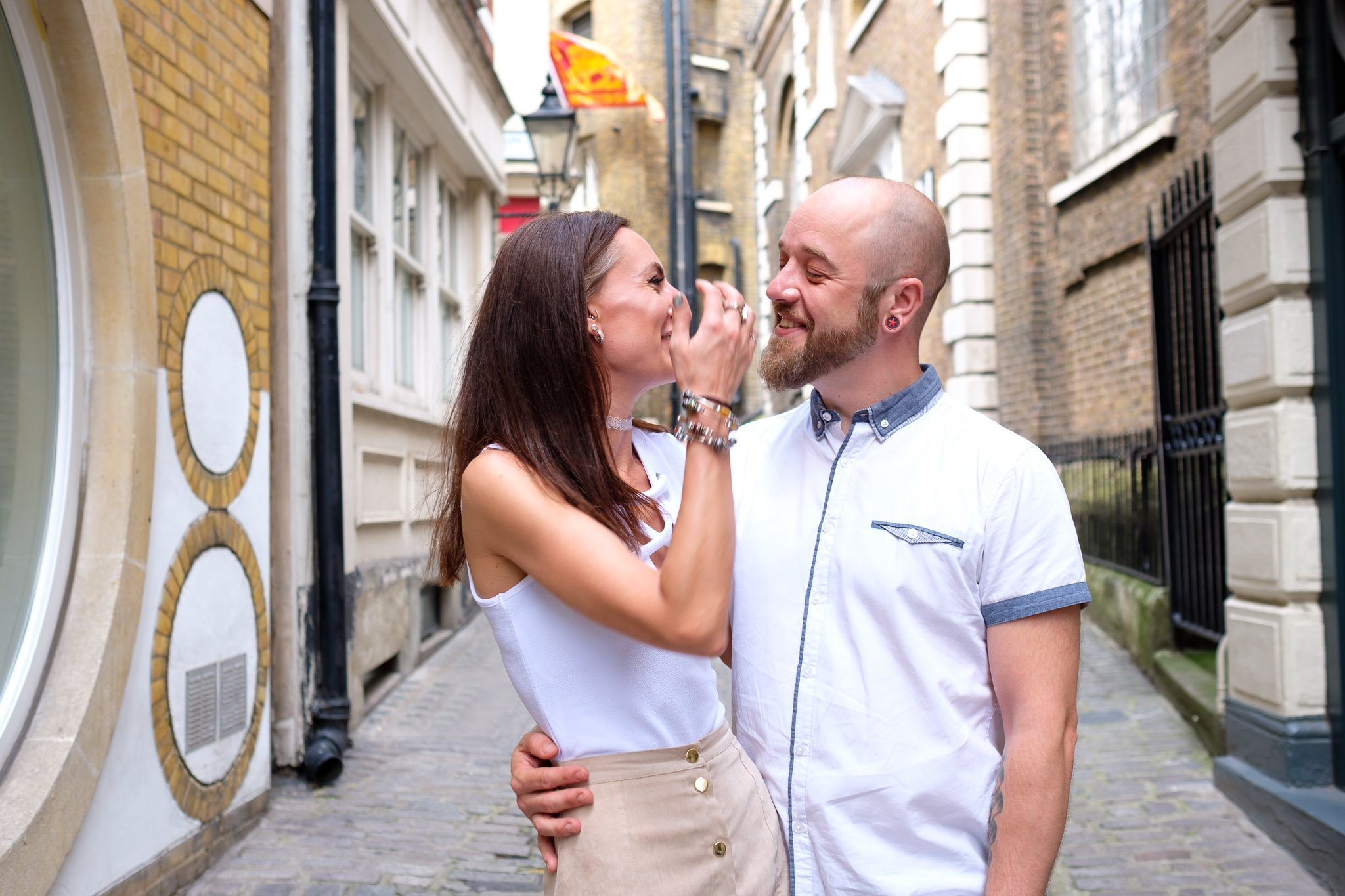 Engagement portrait of couple on cobbled street in London