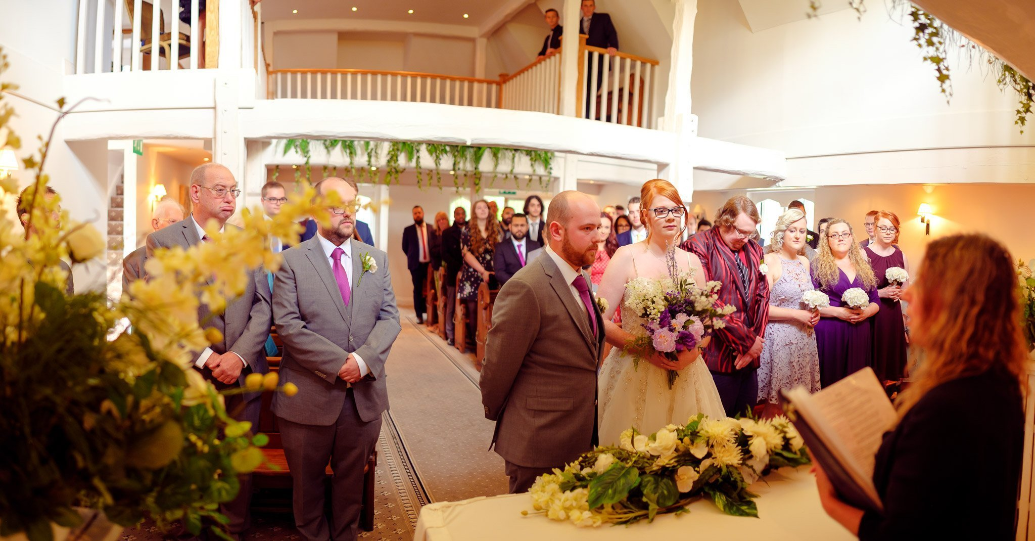 Creative panoramic view of wedding ceremony at The Chapel at Orsett Hall Hotel Essex Wedding