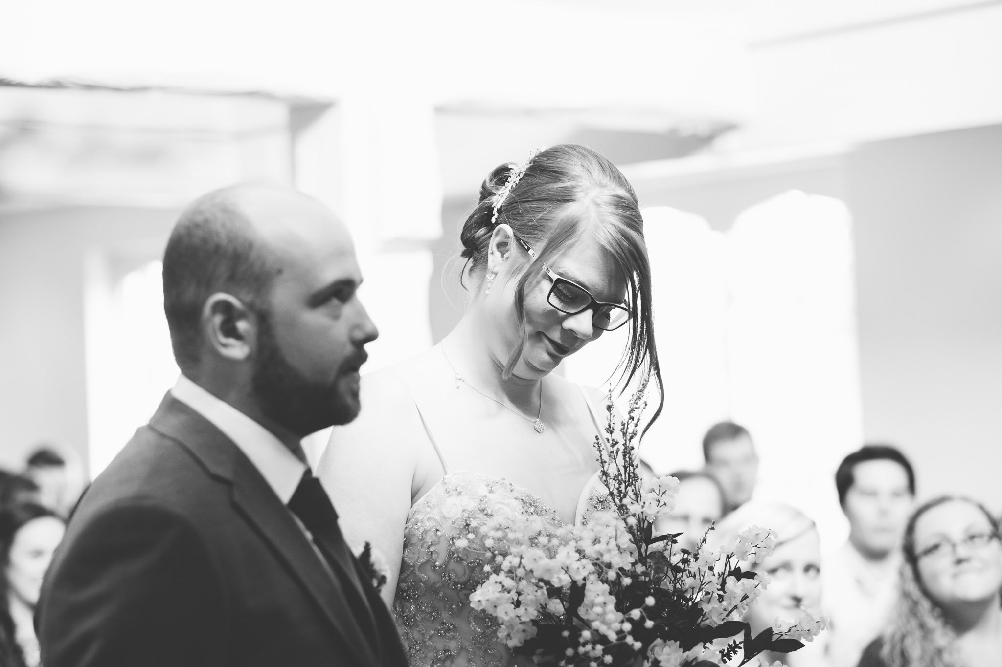 Excited bride and groom at wedding ceremony at The Chapel at Orsett Hall Hotel Essex Wedding