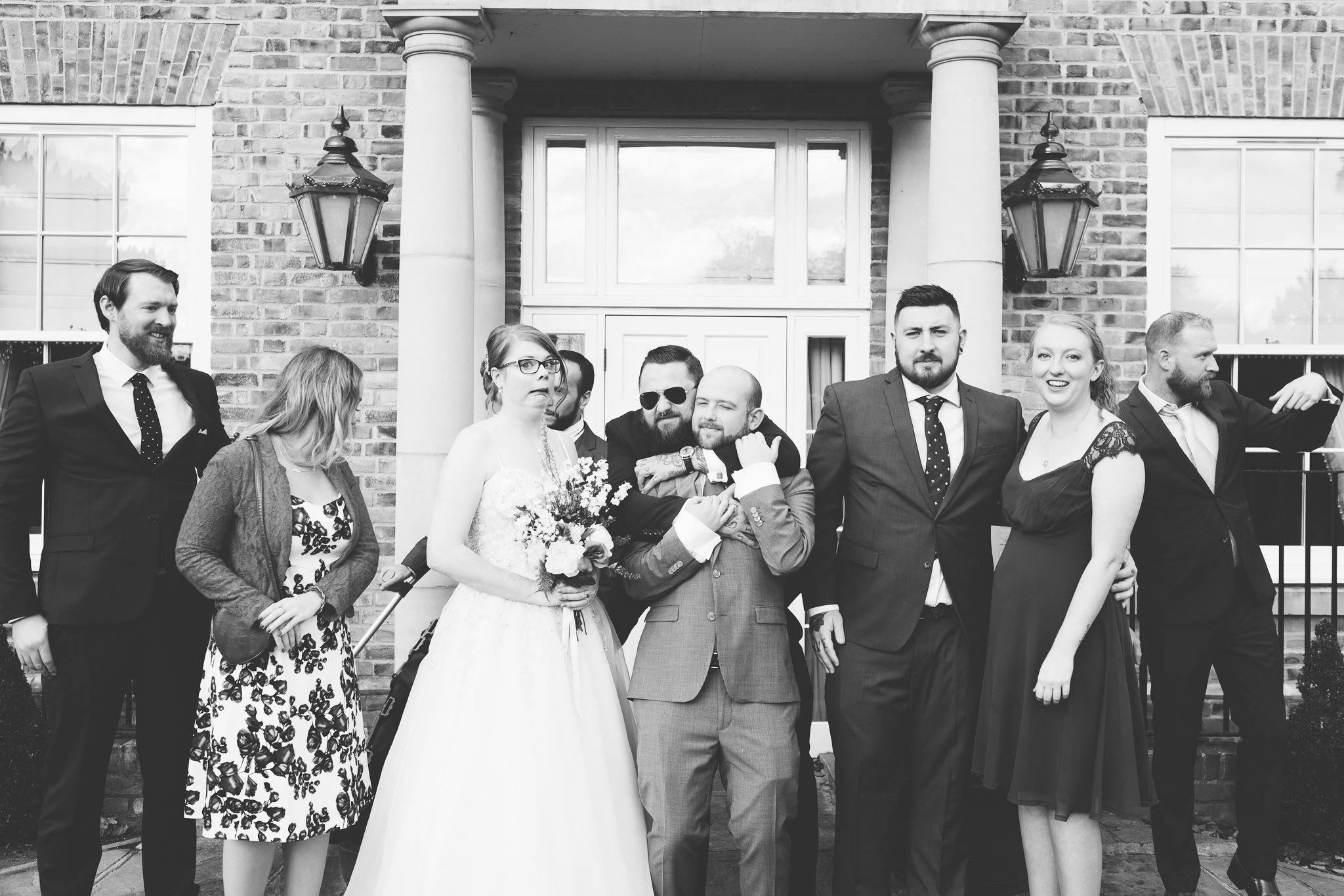 Outtake from a group shot outside Orsett Hall Hotel Essex Wedding