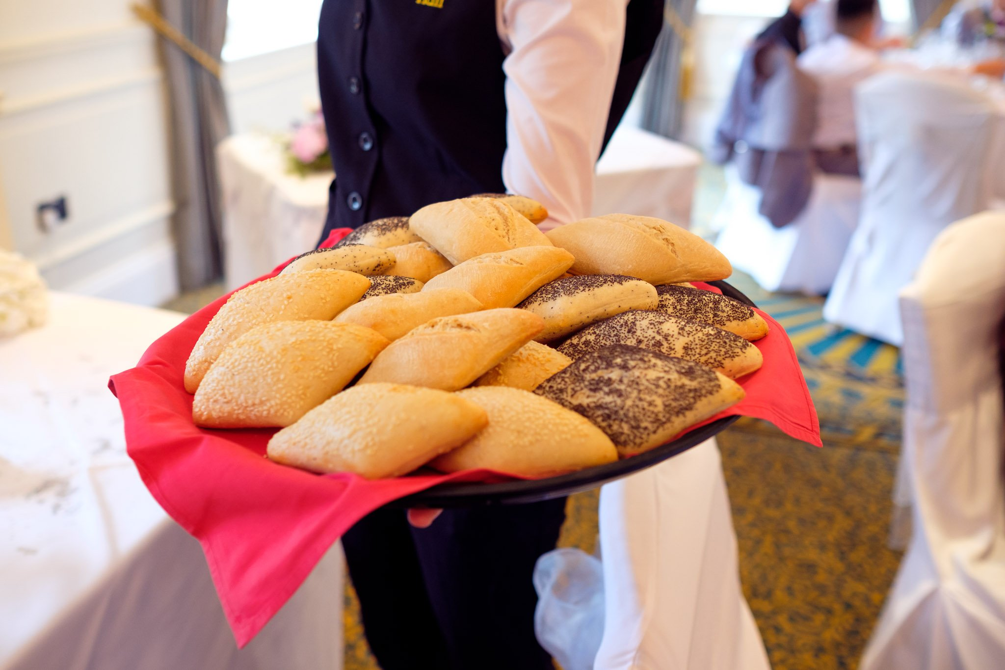 Close up of bread being served at Wedding reception at Orsett Hall Hotel Essex
