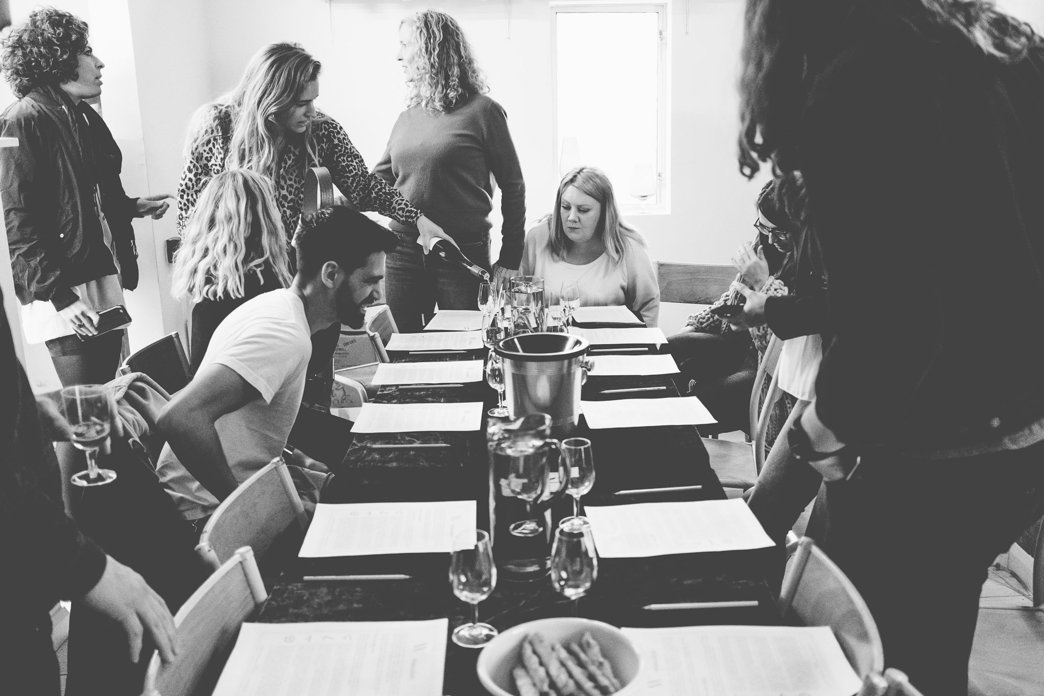 Resident's take their seat at a table at Winecdote, Netil House. Photography by thatthingyoupluck.