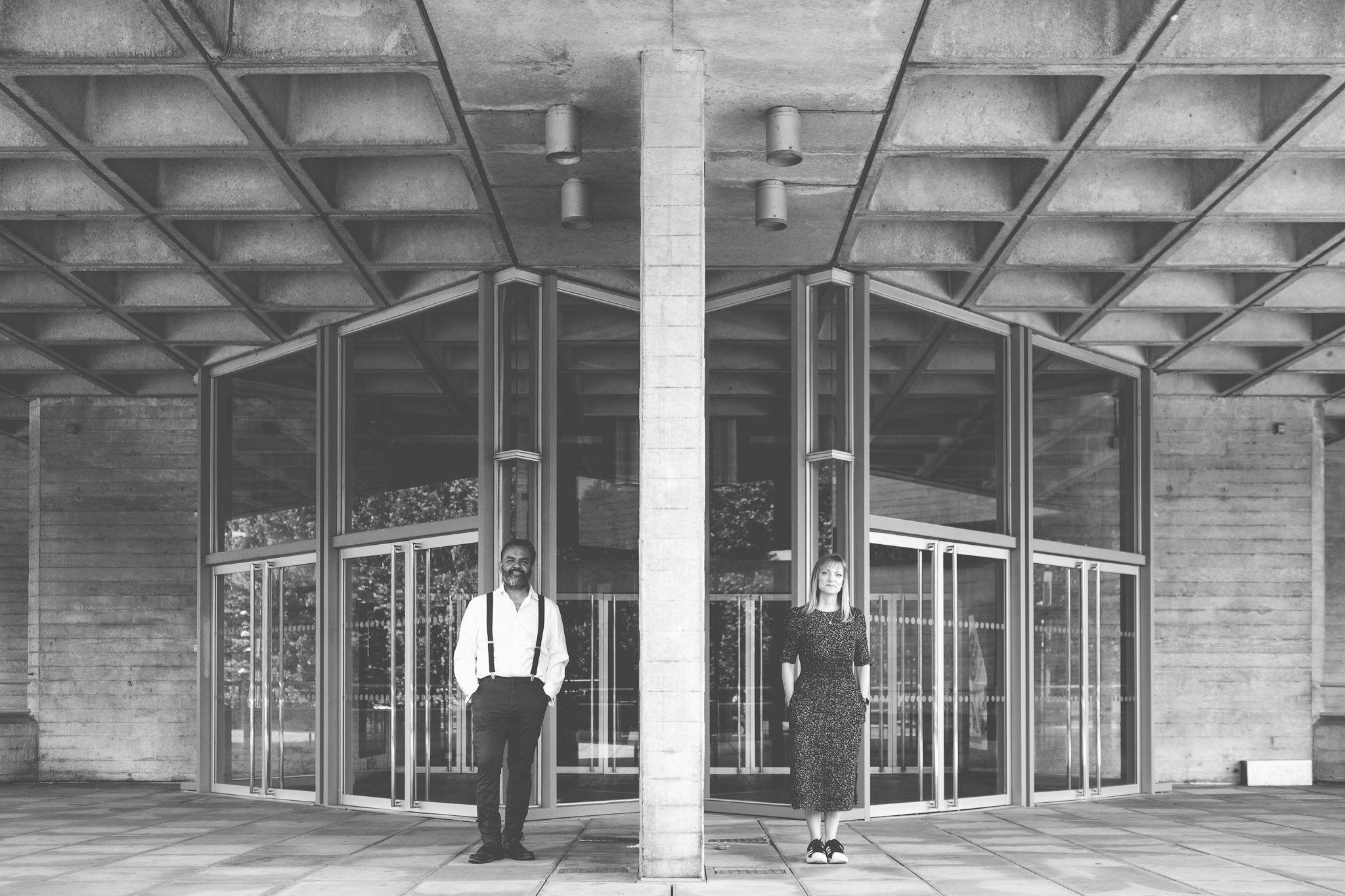 Couple standing in front of the Southbank Centre London engagement shoot. Photography by thatthingyoupluck.