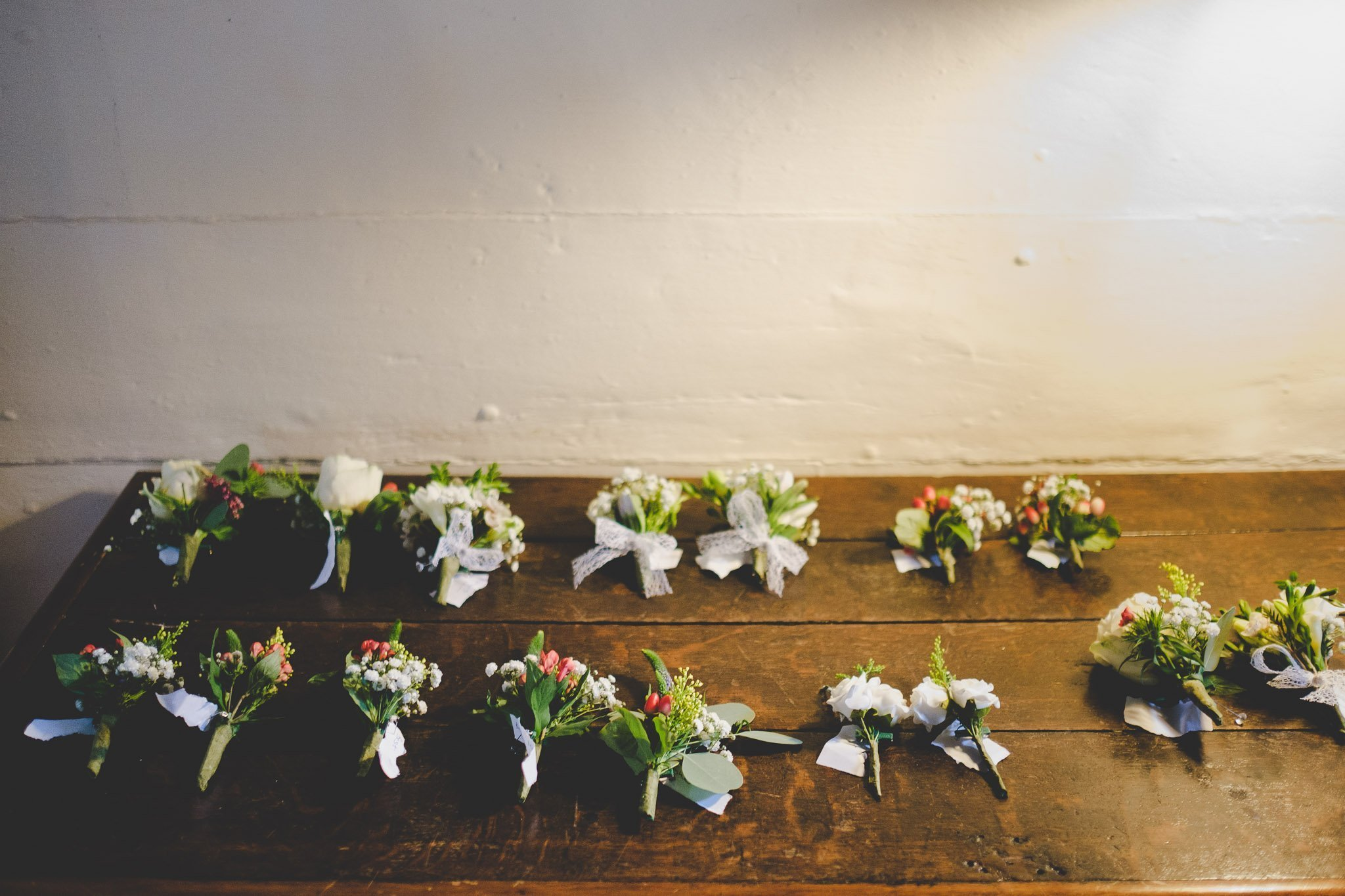 Wedding flower buttonhole's lying on a side table