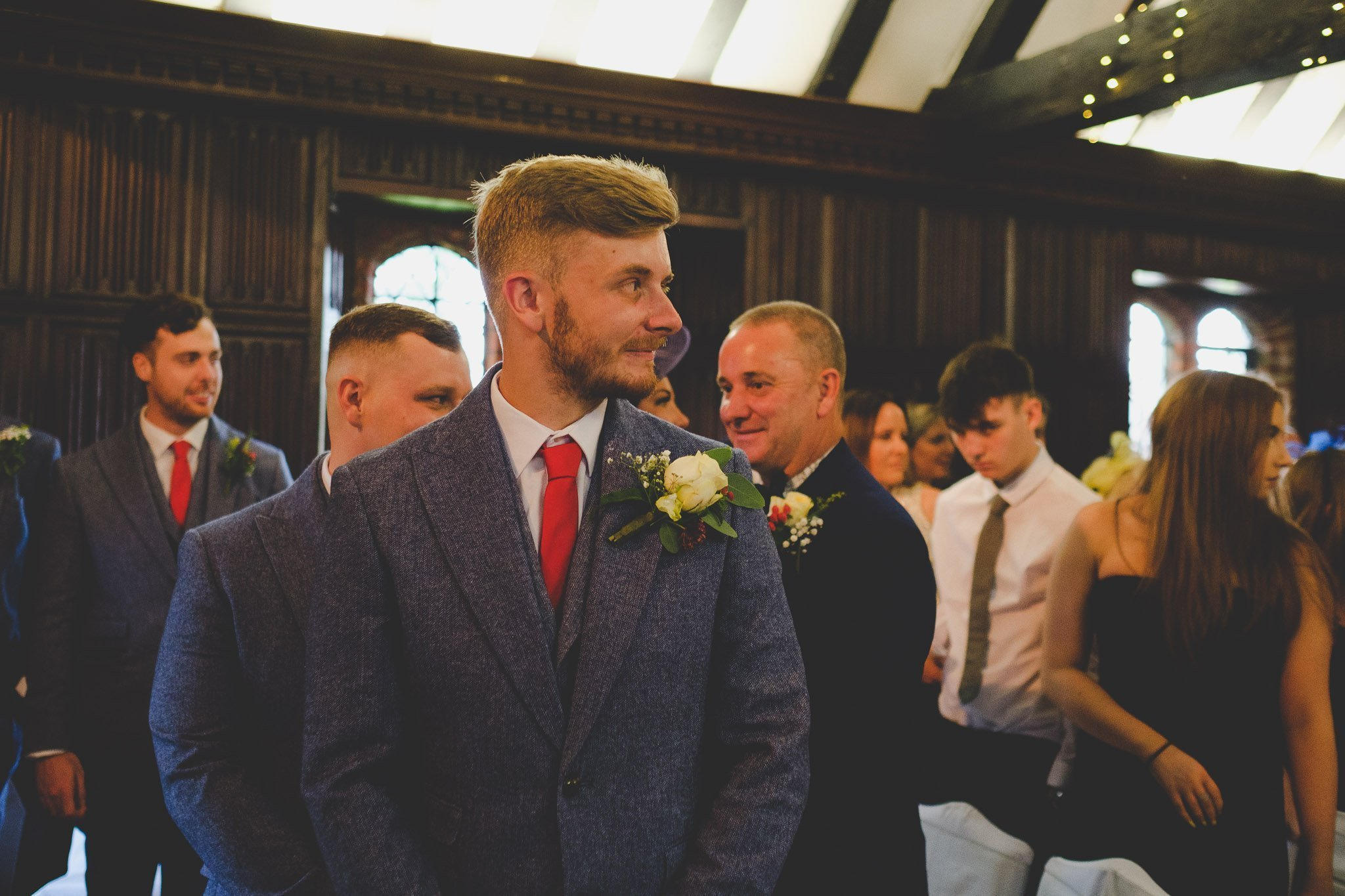 Groom excitedly waits for bride to arrive for ceremony at Leez Priory wedding