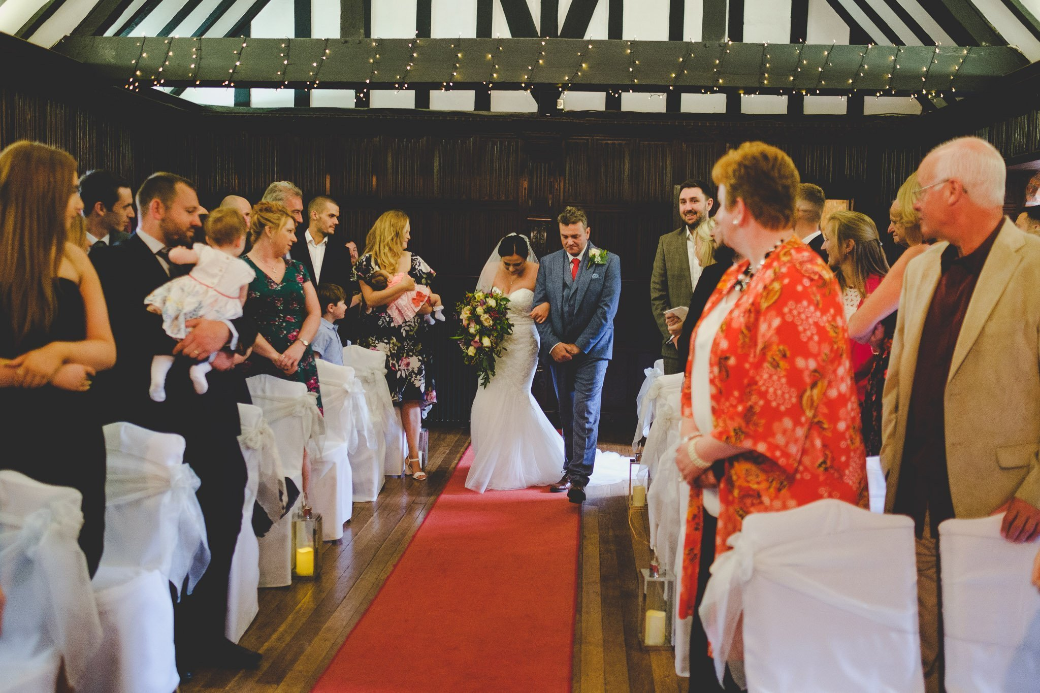 Father walking bride down the aisle at Leez Priory wedding