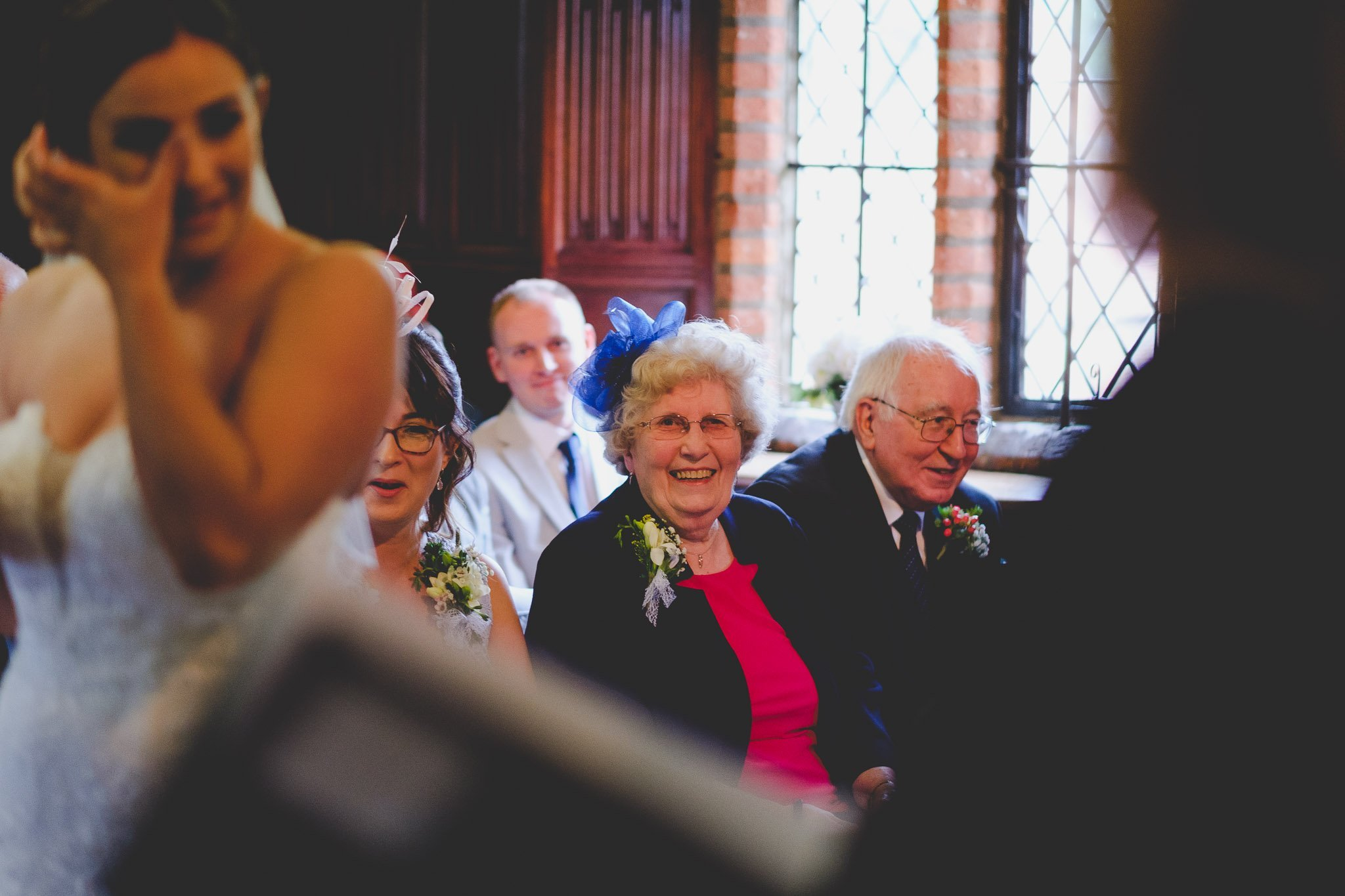 Laughing wedding guest at Leez Priory wedding