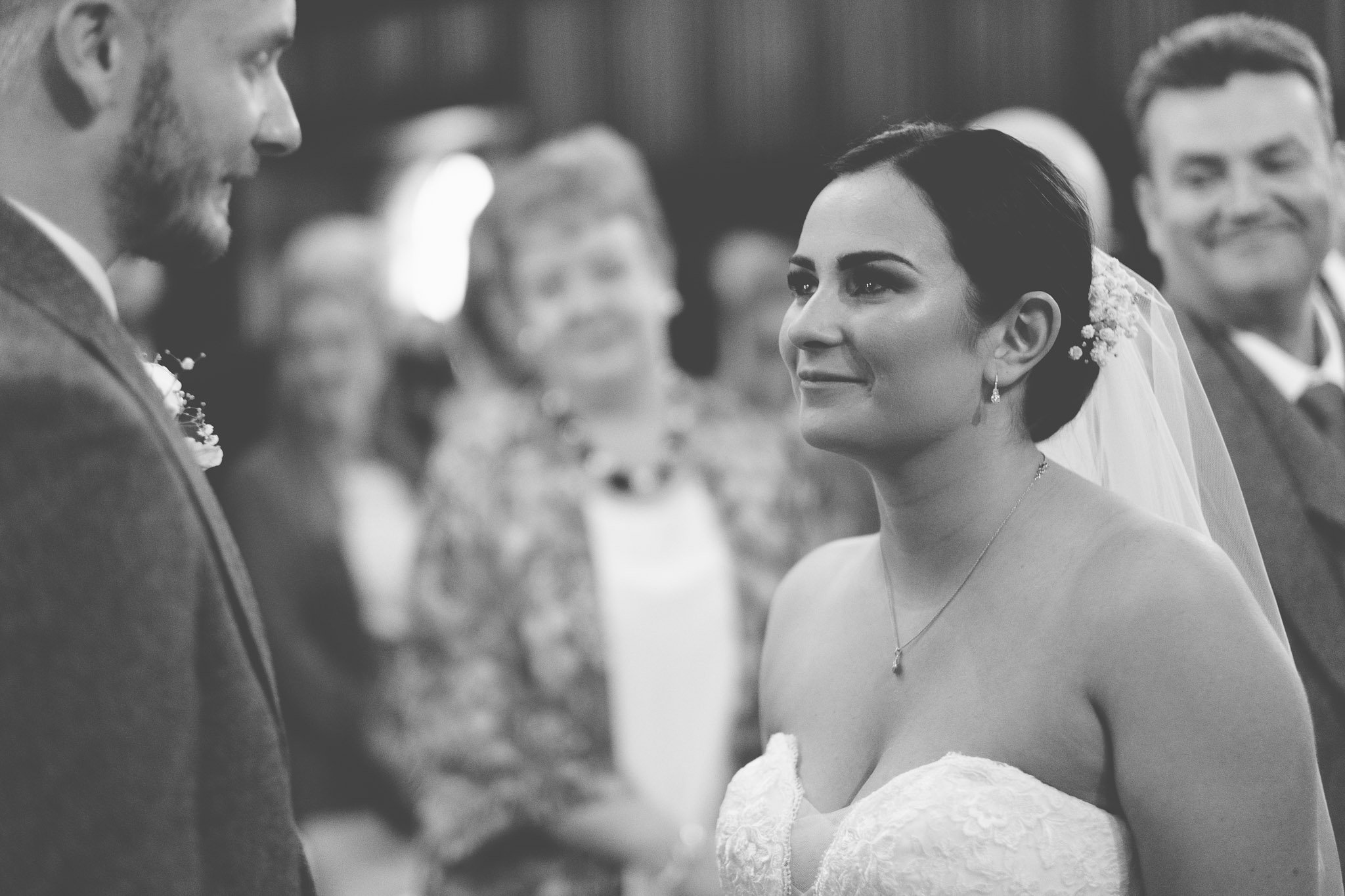 Bride and groom looking at each other during ceremony at Leez Priory wedding