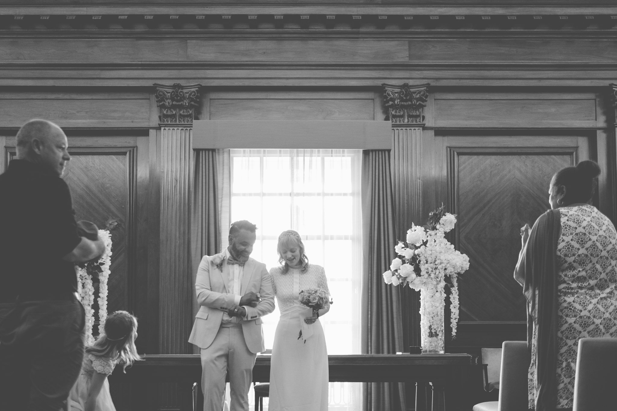 Just married bride & groom in the Westminster Room of the Old Marylebone Town Hall London.