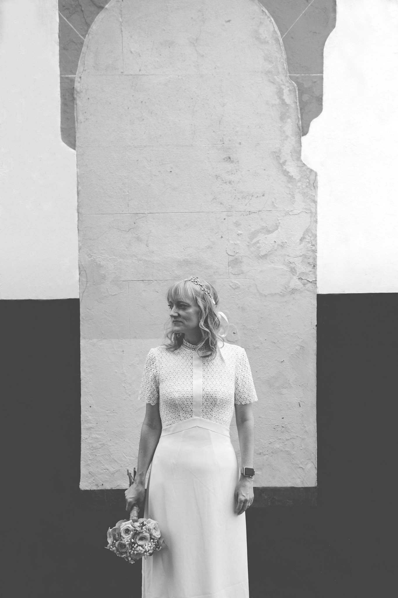 Creative portrait of a bride in front of a wall in London. Photography by thatthingyoupluck.