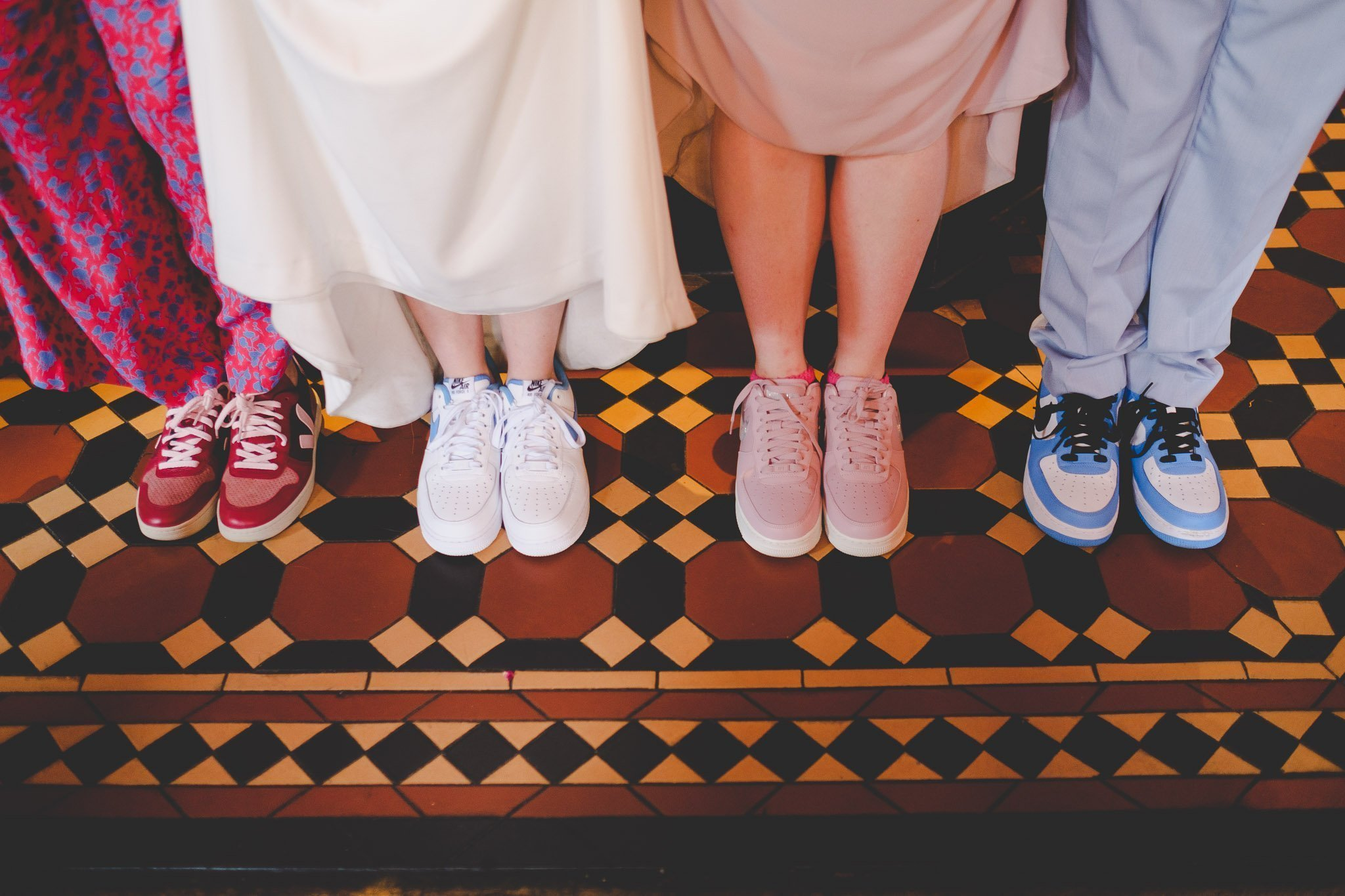 Guests trainers at a wedding reception in The Marquis Cornwallis Pub Bloomsbury London