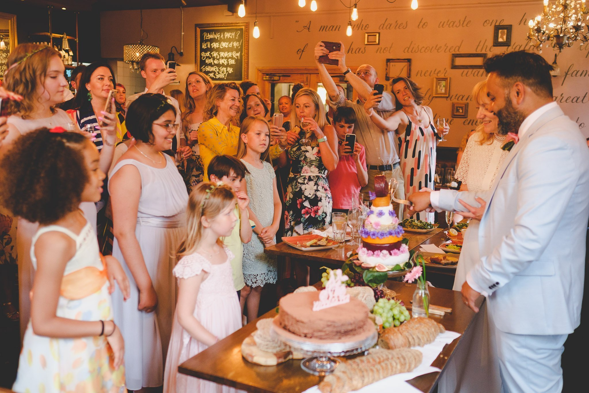 Cake cutting at wedding reception in The Marquis Cornwallis Pub in Bloomsbury London
